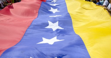 Venezuelan flag and people