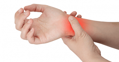 Person holds wrist in pain
